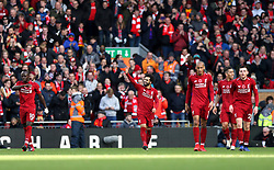Liverpool's Mohamed Salah (centre) celebrates scoring his side's first goal of the game during the Premier League match at Anfield, Liverpool.