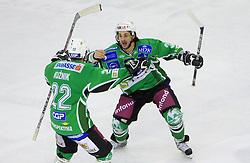 Greg Kuznik and Frank Banham celebrate  at 39th Round of EBEL League ice hockey match between HDD Tilia Olimpija and HK Acroni Jesenice, on December 30, 2008, in Arena Tivoli, Ljubljana, Slovenia. Tilia Olimpija won 4:3. (Photo by Vid Ponikvar / SportIda).