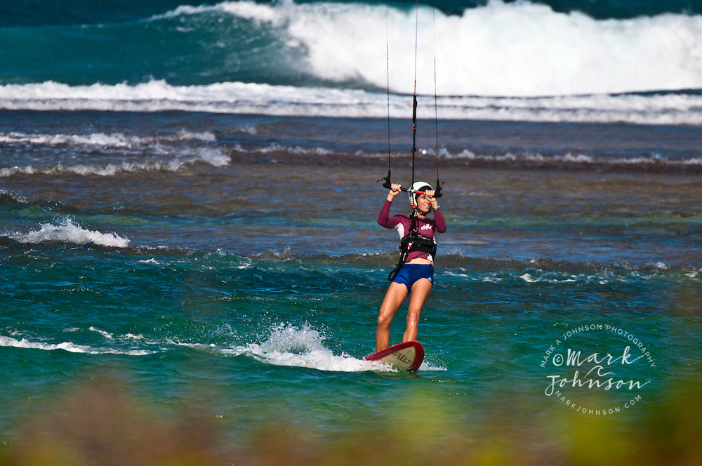 Woman kitesurfing, Kauai, Hawaii ****Model Release available