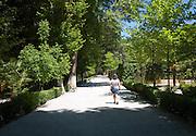 Woman walking in the gardens of the Balneario de Granada hotel, Alhama de Granada, Spain