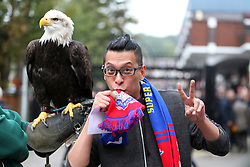 Crystal palace mascot Kayla the American Bald Eagle with a fan before the game