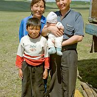 MONGOLIA.  Herding family near Ulaan Uul in southern Horidal Saridag Mountains.