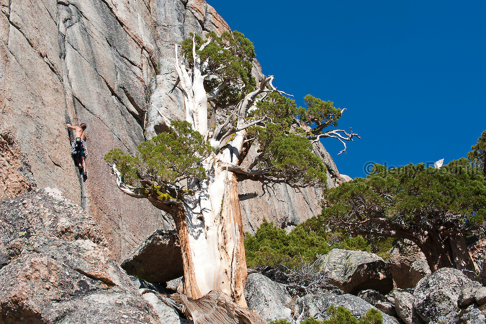 """Brad Parker climbing """"For Whom the Bell Tolls"""" (5.10c) at Chipmonk Flat, Sonora Pass, Sierra Nevada Mountains, California"""