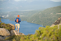 Young man hiking near Donner Pass, CA.