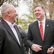 Monacan Chief, Dean Branham, left, greets former Virginia Governor, George Allen prior to the dedication ceremony for Mantle: Virginia Indian Tribute, a monument designed on Virginia State Capitol Square, in Richmond, Virginia, on Tuesday, April 17, 2018. As a U.S. Senator, George Allen first introduced the Thomasina E. Jordan bill along with Sen. John Warner, federally recognizing Monacan Indian Nation along with 5 other Virginia Tribes. This past January, the bill was signed into law. John Boal Photography