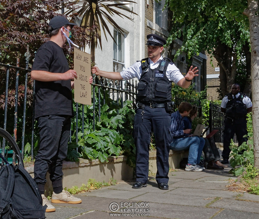 """London, United Kingdom - 24 May 2020<br /> Police outside Dominic Cummings home. The scenes unfolding today at Dominic Cummings home in North London. Boris Johnsons political advisor spent the day in discussions with the Prime Minister after accusations of breaking the Corona virus lockdown. Neighbours and passers-by protested and shouted """"hypocrite"""", """"resign"""" and """"shame on you"""" when he returned to his house. London, England, UK.<br /> **VIDEO AVAILABLE**<br /> (photo by: HAUSARTS / EQUINOXFEATURES.COM)<br /> Picture Data:<br /> Photographer: Hausarts / Equinox Features<br /> Copyright: ©2020 Equinox Licensing Ltd. +443700 780000<br /> Contact: Equinox Features<br /> Date Taken: 20200524<br /> Time Taken: 15072100<br /> www.newspics.com"""