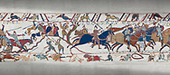 Bayeux Tapestry scene 54: Bishop Odo, holding club, urges Norman cavalry against the Saon soldiers on a hill at the Battle of Hastings. .<br /> <br /> If you prefer you can also buy from our ALAMY PHOTO LIBRARY  Collection visit : https://www.alamy.com/portfolio/paul-williams-funkystock/bayeux-tapestry-medieval-art.html  if you know the scene number you want enter BXY followed bt the scene no into the SEARCH WITHIN GALLERY box  i.e BYX 22 for scene 22)<br /> <br />  Visit our MEDIEVAL ART PHOTO COLLECTIONS for more   photos  to download or buy as prints https://funkystock.photoshelter.com/gallery-collection/Medieval-Middle-Ages-Art-Artefacts-Antiquities-Pictures-Images-of/C0000YpKXiAHnG2k
