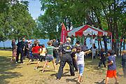 Teachers and students of the Kuk Sool Won school practice martial arts. Dragon Festival Lake Phalen Park St Paul Minnesota USA