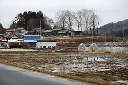 """Abandoned fields and houses are seen in the town of Iitate, Fukushima Prefecture, Japan, March 7, 2015. The scenes from the towns and villages still abandoned four years after an earthquake triggered tsunami breached the defenses of the Fukushima Daiichi nuclear power plant, would make for the perfect backdrop for a post- apocalyptic Hollywood zombie movie, but the trouble would be that the levels of radiation in the area would be too dangerous for the cast and crew. The central government's maxim of """"Everything is under control"""" in and around the nuclear plant, has been a blatant lie since the disaster began to unfold on March 11, 2011, quickly escalating into the worst civilian nuclear crisis ever to happen, with twice the amount of radioactive materials being released into the environment than the Chernobyl disaster in 1986. EXPA Pictures © 2015, PhotoCredit: EXPA/ Photoshot/ Liu Tian<br /> <br /> *****ATTENTION - for AUT, SLO, CRO, SRB, BIH, MAZ only*****"""