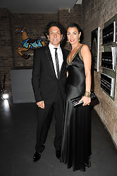 STEPHEN & ASSIA WEBSTER at The Love Ball hosted by Natalia Vodianova and Lucy Yeomans to raise funds for The Naked Heart Foundation held at The Round House, Chalk Farm, London on 23rd February 2010.