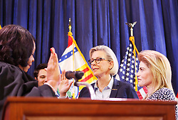 May 1, 2019 - Tampa, Florida, U.S. - Mayor JANE CASTOR smiles with her partner ANA CRUZ takes the oath of office from Mayor of Tampa by U.S. District Judge MARY SCRIVEN on Wednesday at Armature Works on Wednesday. (Credit Image: © Octavia Jones/Tampa Bay Times via ZUMA Wire)