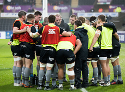 Ospreys forwards huddle during the pre match warm up<br /> <br /> Photographer Simon King/Replay Images<br /> <br /> EPCR Champions Cup Round 4 - Ospreys v Northampton Saints - Sunday 17th December 2017 - Parc y Scarlets - Llanelli<br /> <br /> World Copyright © 2017 Replay Images. All rights reserved. info@replayimages.co.uk - www.replayimages.co.uk