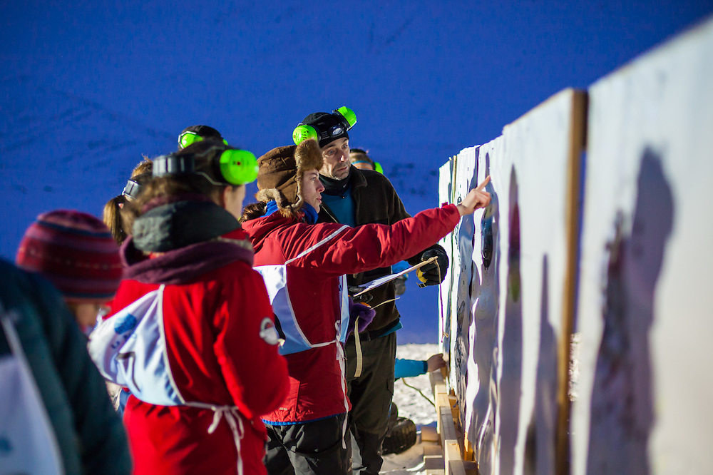 Heidi Rosendahl Lindebotten (center) and other UNIS students check their accuracy at a shooting range outside Longyearbyen, Svalbard. The university center's basic safety training focuses on polar bear encounters and snowmobile driving.