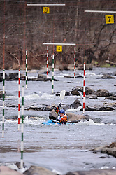 Piper Wall of Ames, Iowa races in the K1 women's short plastic class during the slalom course of the 42nd Annual Missouri Whitewater Championships. Wall placed first place in the class. The Missouri Whitewater Championships, held on the St. Francis River at the Millstream Gardens Conservation Area, is the oldest regional slalom race in the United States.