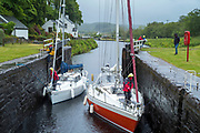 Yachts in a lock on Crinan Canal at Cairbaan near Lochgilphead, Argyll and Bute, Scotland