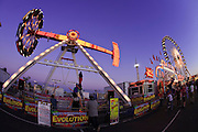 """Oct 14, 2008 -- PHOENIX, AZ: The """"Evolution"""" ride at the Arizona State Fair. The Arizona State Fair started Oct.  10 and runs through Nov. 2. Carnival and midway workers who have worked the fair for years say attendance so far is much lower than in the past and people at the fair this year aren't spending as much money as they have in the past. Photo by Jack Kurtz / ZUMA Press"""