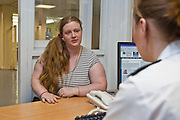 A member of the reception team interview all new arrivals into the prison discussing their concerns before they begin custody at HMP Holloway, the main womens prison in London.