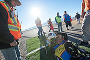 Liz McTernan with the handbike Red Lighting. In Battle Mountain (Nevada) wordt ieder jaar de World Human Powered Speed Challenge gehouden. Tijdens deze wedstrijd wordt geprobeerd zo hard mogelijk te fietsen op pure menskracht. Ze halen snelheden tot 133 km/h. De deelnemers bestaan zowel uit teams van universiteiten als uit hobbyisten. Met de gestroomlijnde fietsen willen ze laten zien wat mogelijk is met menskracht. De speciale ligfietsen kunnen gezien worden als de Formule 1 van het fietsen. De kennis die wordt opgedaan wordt ook gebruikt om duurzaam vervoer verder te ontwikkelen.<br /> <br /> Liz McTernan with the handbike Red Lighting. In Battle Mountain (Nevada) each year the World Human Powered Speed Challenge is held. During this race they try to ride on pure manpower as hard as possible. Speeds up to 133 km/h are reached. The participants consist of both teams from universities and from hobbyists. With the sleek bikes they want to show what is possible with human power. The special recumbent bicycles can be seen as the Formula 1 of the bicycle. The knowledge gained is also used to develop sustainable transport.