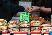A busy bakery selling fresh bagels on Columbia Road during Columbia Road Flower Market on the 6th October 2019 in London in the United Kingdom. Columbia Road Flower Market is a street market in Bethnal Green in Hackney, London. The market is open on Sundays only.