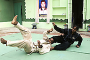 Geetan Jali Panda, 34, the wife of Biranchi Das, the recently murdered coach of Budhia Singh demonstrating some moves to her class in their Judo Hall, taking over her defunct husband work, in Bhubaneswar, the capital of Orissa State, on Saturday, May 17, 2008. On May 1, 2006, Budhia completed a record breaking 65 km run from Jagannath temple, Puri to Bhubaneswar. He was accompanied by his coach Biranchi Das and by the Central Reserve Police Force (CRPF). On 8th May 2006, a Government statement had ordered that he stopped running. The announcement came after doctors found the boy had high blood pressure and cardiological stress. As of 13th August 2007 Budhia's coach Biranchi Das was arrested by Indian police on suspicion of torture. Singh has accused his coach of beating him and withholding food. Das says Singh's family are making up charges as a result of a few petty rows. On April 13, Biranchi Das was shot dead in Bhubaneswar, in what is believed to be an event unconnected with Budhia, although the police is investigating the case and has made an arrest, a local goon named Raja Archary, which is now in police custody. **Italy and China Out**