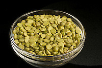 Dry split green peas in a glass bowl.
