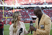 FOX Sports sideline reporter Erin Andrews and former San Francisco 49ers wide receiver Terrell Owens in action during the NFL week 9 regular season football game against the Oakland Raiders on Thursday, Nov. 1, 2018 in Santa Clara, Calif. The 49ers won the game 34-3. (©Paul Anthony Spinelli)