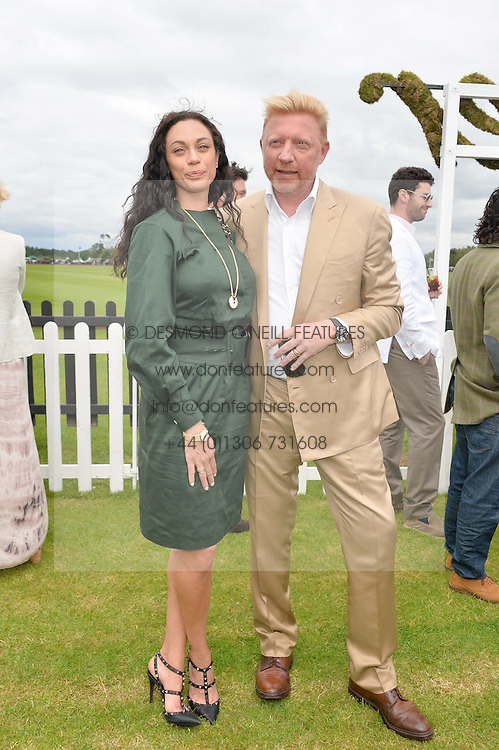 BORIS & LILLY BECKER at the Cartier Queen's Cup Final polo held at Guards Polo Club, Smith's Lawn, Windsor Great Park, Egham, Surrey on 15th June 2014.