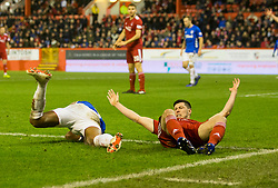 Rangers Alfredo Morelos (left) and Aberdeen's Scott Mckenna clash, resulting in them both receiving a red card during the Ladbrokes Scottish Premiership match at Pittodrie Stadium, Aberdeen.