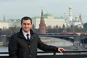 Moscow, Russia, 09/11/2007..Pepsi manager Anton Khrunov with the Kremlin and Moscow River behind.
