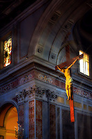 """""""Celestial light illuminates the crucifix - Cathedral of Sorrento""""…<br /> <br /> The main church in Sorrento is the Duomo, also known as the Cathedral of San Filippo and San Giacomo, which is concealed right in the heart of the town.  Sorrento is not known as a pilgrimage site, but a beautiful seaside resort village. The Duomo dates as far back as the 11th century but was completely rebuilt in the 15th century in Romanesque style. The façade is very plain for a Cathedral of such interior grandeur, which has three naves separated by pillars and a very ornate ceiling. Next to the cathedral is a bell tower resting on an arch with four columns, which dates back to medieval times.  Inconspicuously, I entered the cathedral and saw only a dozen elderly women sitting in the front pews reciting aloud a novena.  Not wanting to disturb them, I ventured around quietly and was taken aback by the reverent beauty and peaceful aura of the magnificent Duomo.  Hanging above the Altar was a lifelike Crucifix. It was not as large as it appears in the photos; however, the closer I ventured…the more mesmerized I became.  Slowly and quietly moving about, from different angles I was able to capture dramatic images of window light mystically illuminating Christ.  This image with the sunlight shining through the window is one of the most meaningful and favorite images from my Italian journey.  I believe that if you gaze for a minute or two, you will also be transported on a remarkable journey."""