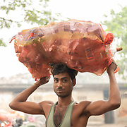 The houses of garbage collectors that recycle the garbages. A visit to one of the main garbage dump. With 15 millions population in 2019 and growing, the city of Calcutta is a typical case of expansion through uncontrolled urbanization.