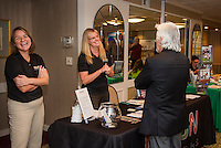 Erin Makarow and Denise Howard of RMON Networks talk with Ron Stevens during the Lakes Region Business Resource Fair at the Margate Wednesday morning.  (Karen Bobotas/for the Laconia Daily Sun)