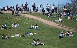 © Licensed to London News Pictures. 29/03/2021. London, UK. Members of the public relax in the warm weather on Primrose, Hill in North London, on the day that some lockdown restrictions are eased. Photo credit: Ben Cawthra/LNP