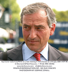 Top trainer LUCA CUMANI at a race meeting in West Sussex on 27th July 2004.PXM 98