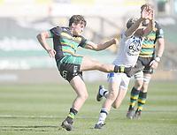Rugby Union - 2020 / 2021 Gallagher Premiership - Round 11 - Northampton Saints vs Bath - Franklin Gardens<br /> <br /> Northampton Saints' George Furbank clears under pressure from Bath Rugby's Rhys Priestland.<br /> <br /> COLORSPORT/ASHLEY WESTERN