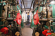****COPY HERE****  (https://www.dropbox.com/s/5mg81qiiuy22tre/adamson.rtf?dl=0)   © Licensed to London News Pictures. 02/12/2014. Liverpool , UK . Volunteer John Churchill in the partially restored engine room. The only surviving steam powered tug tender, the Daniel Adamson, is being completely renovated by a team of volunteers in Liverpool. The vessel, which has had 90,000 man hours already spent on it, was bought for only one pound is the awaiting the decision of the Heritage Lottery Fund on an application of £3.6m to bring her back to her full glory.  . Photo credit : Stephen Simpson/LNP<br /> <br /> COPY HERE https://www.dropbox.com/s/5mg81qiiuy22tre/adamson.rtf?dl=0
