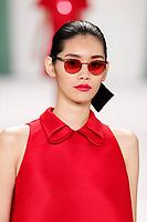 Ming Xi walks the runway wearing Carolina Herrera Spring 2015 during Mecedes-Benz Fashion Week in New York on September 8th, 2014