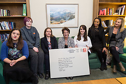 Apprentices from across the UK , left to right, Project management apprentice Leah Tipping, 20, Fleet apprentice Caitlin Slade, 29, project Management apprentice Katherine Palmer, 38, HR apprentice Sara McGinlay, Talent Pipeline Manager Louisa Joseph, Apprenticeships programme manager Paula Gibson, meet Apprenticeships minister Rt. Hon. Anne Milton MP, centre, at the House of commons as Royal Mail launches a postmark to commemorate Apprenticeships Week. House of Commons, London, March 07 2018.
