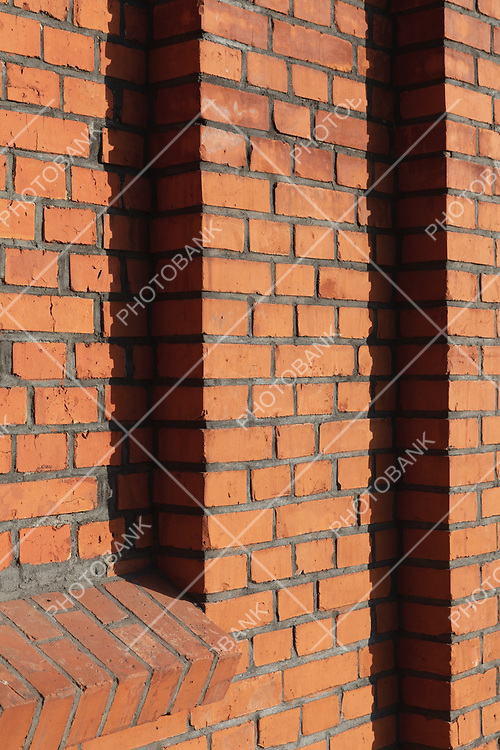 Wall with red brick edges.