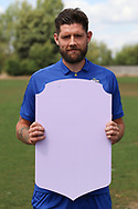 AFC Wimbledon midfielder Anthony Wordsworth (40) holding Fifa sign during the AFC Wimbledon 2018/19 official photocall at the Kings Sports Ground, New Malden, United Kingdom on 31 July 2018. Picture by Matthew Redman.