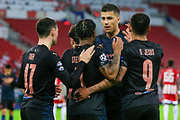 PIRAEUS, GREECE - NOVEMBER 25: Phil Foden of Manchester City celebrates his goal with his teammates during the UEFA Champions League Group C stage match between Olympiacos FC and Manchester City at Karaiskakis Stadium on November 25, 2020 in Piraeus, Greece. (Photo by MB Media)