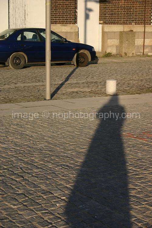Photographers shadow on cobblestones, low light, Dublin, Ireland