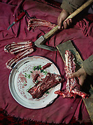 Yahyah baig cutting lamb meat with an ax. In Shimshal, one of the remotest village in the Karakoram mountains, and the highest settlement in the Hunza and Gojal region.