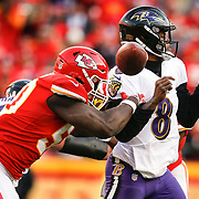 KANSAS CITY, MO - DECEMBER 09: Outside linebacker Justin Houston #50 of the Kansas City stripped the football out of the hands of quarterback Lamar Jackson #8 of the Baltimore Ravens late in the fourth quarter at Arrowhead Stadium on December 9, 2018 in Kansas City, Missouri. Houston recovered the fumble. (Photo by David Eulitt/Getty Images)