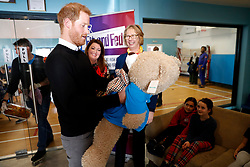 The Duke of Sussex is given the gift of a large teddy during a visit to Streatham Youth and Community Trust's John Corfield Centre to see a 'Fit and Fed' February half-term holiday activity programme.