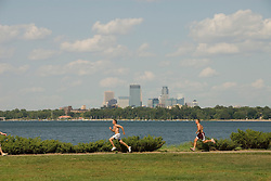 Minnesota, Twin Cities, Minneapolis-Saint Paul: Recreation at the south end of Lake Calhoun, with the Minneapolis skyline in the background..Photo mnqual270-75182..Photo copyright Lee Foster, www.fostertravel.com, 510-549-2202, lee@fostertravel.com.