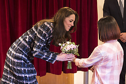 The Duchess of Cambridge receives a posy of flowers during a visit to Francis House hospice in Manchester.