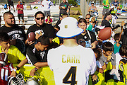 January 28 2016: Oakland Raiders quarterback Derek Carr signs autographs after the Pro Bowl practice at Turtle Bay Resort on North Shore Oahu, HI. (Photo by Aric Becker/Icon Sportswire)