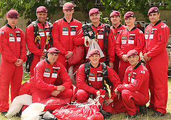 © Licensed to London News Pictures. 30/05/2015. UK Red Devils team picture taken in May at Royal Bath and West Show. Yesterday, 19th June 2015, a Red Devil parachutist was caught in mid-air by his team-mate after his chute failed to open during a display at the Whitehaven Air Show. Photo credit : Jason Bryant/LNP