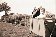 a little child standing in the cradle